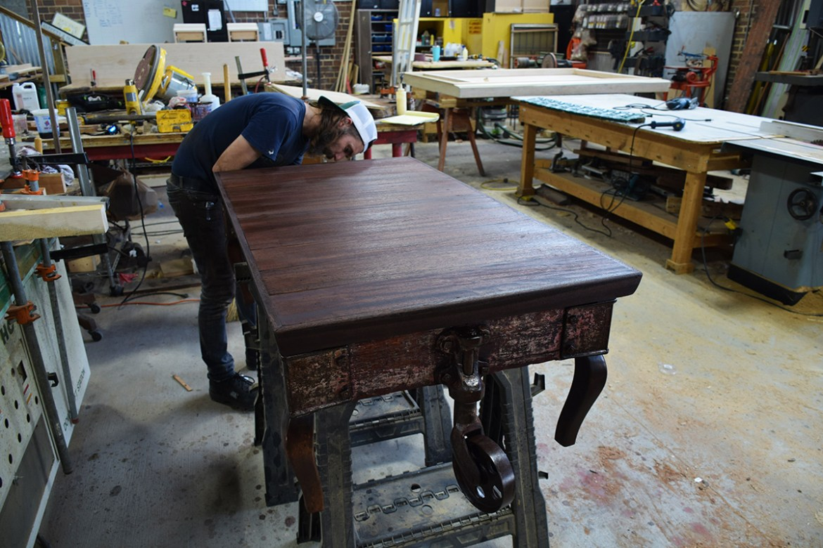 After constructing a new top for this cart using reclaimed Mahogany, Billy Leeka begins the finishing process.