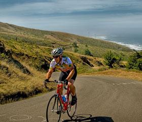 bicyclist on coast