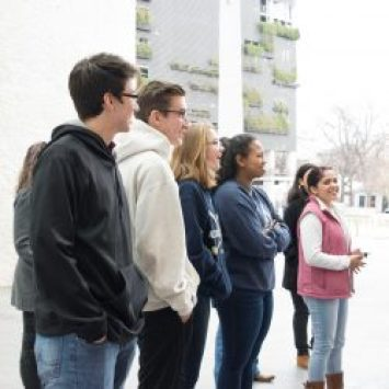 first cohort of green building interns commenting on a cultural mural in austin, texas