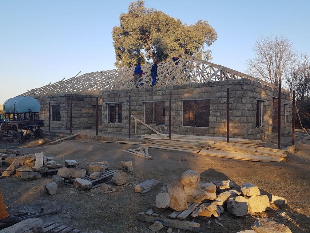 Prefabricated roof truss erection