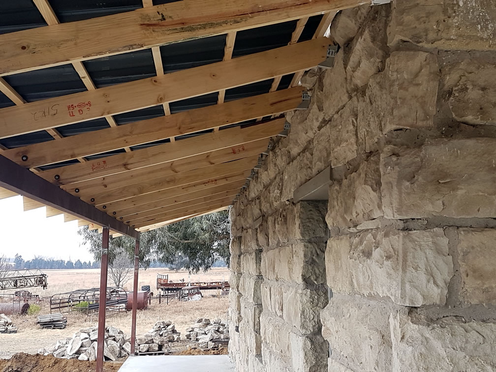Exposed roof trusses made with wood rafters