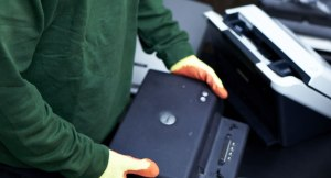 Printer Disposal - Printer Recycling - Printer Collection - Printer removal - London / worker collecting a printer