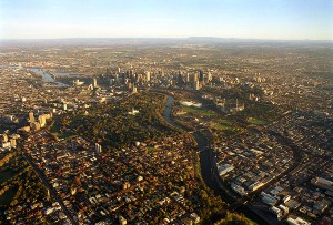 An aerial view of the city of Melbourne showing Yarra River and suburbs