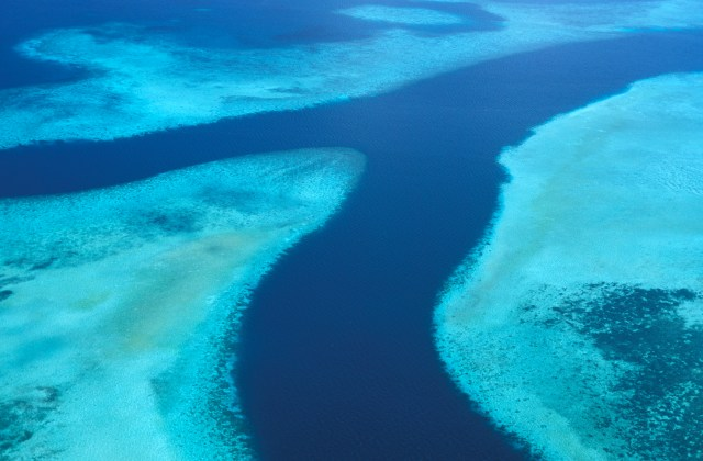 An areial photo of a reef system and channel waters in Palau.