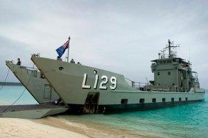A navy landing craft on a beach