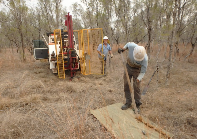 two men and a soil sampling rig at work