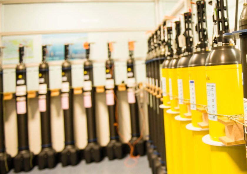 cannisters stacked in rows against the wall
