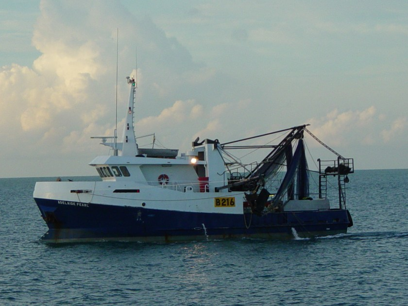 A prawn trawler, viewed from the side.