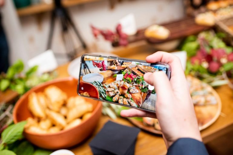 A photo of someone taking a photo of food