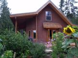 George residence - consulting, foundation, cob, curvilinear double stud framing, earthen floors, and brown coat plaster