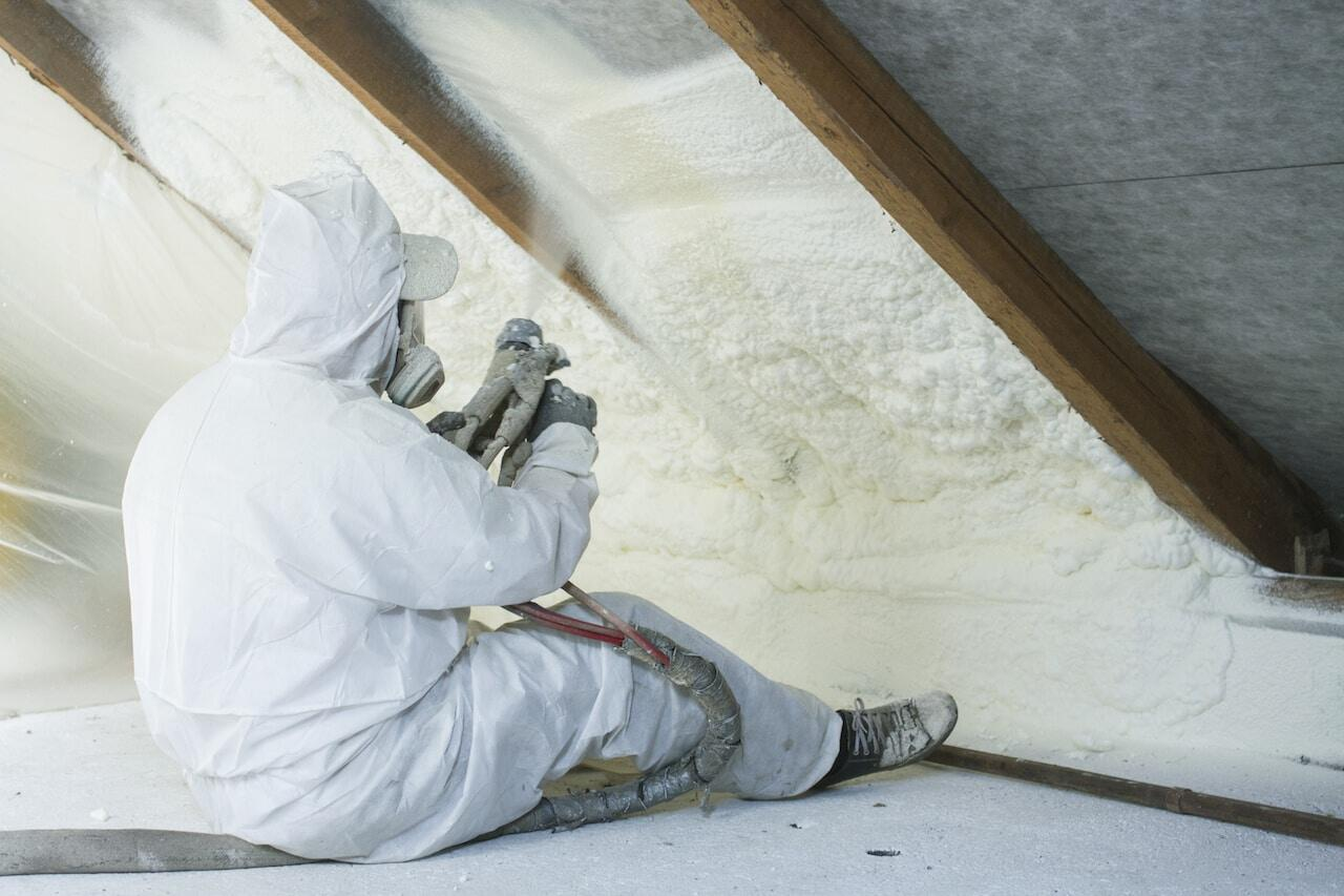 Eco Spray Installer using spray foam in the Attic