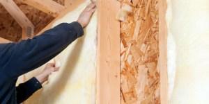Our expert installing fiberglass insulation at an Ontario Home