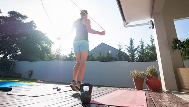 Woman keeping fit by doing some jump rope