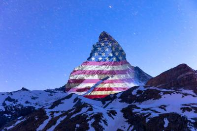 US flag projected on Matterhorn