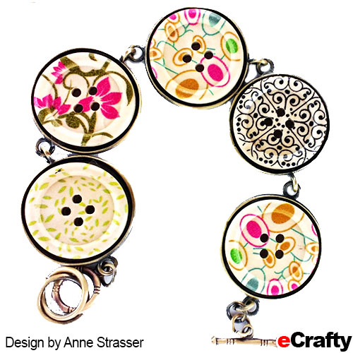 DIY Floral Button Bracelet Recipe from eCrafty.com SKU 1063C Floral Button Mix SKU 1193G-KIT Charm Bracelet Base in Bronze SKU e-6000 Clear Adhesive, or our 800P double sided adhesive film.