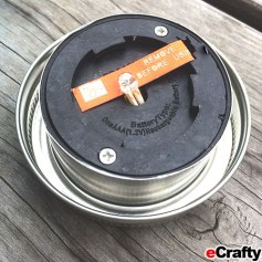 Turn it over, remove the protective strip on the battery. DIY Solar Mason Jar Garden Light or Lighted Treasure Jar from eCrafty.com