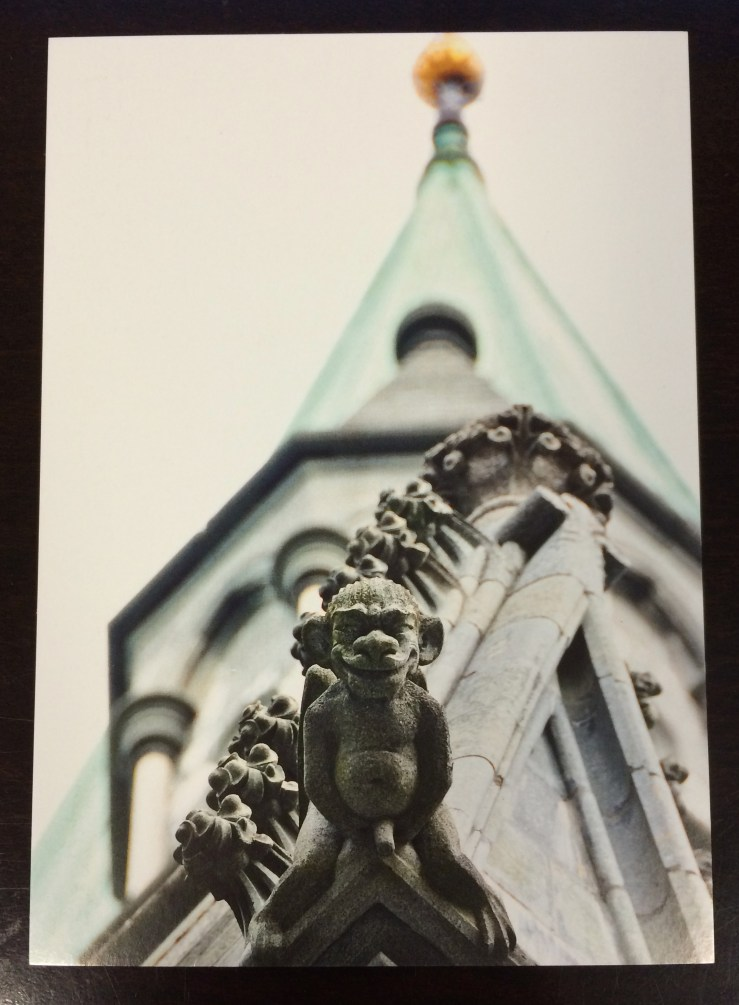 Postcard of a stone monkey holding its weiner
