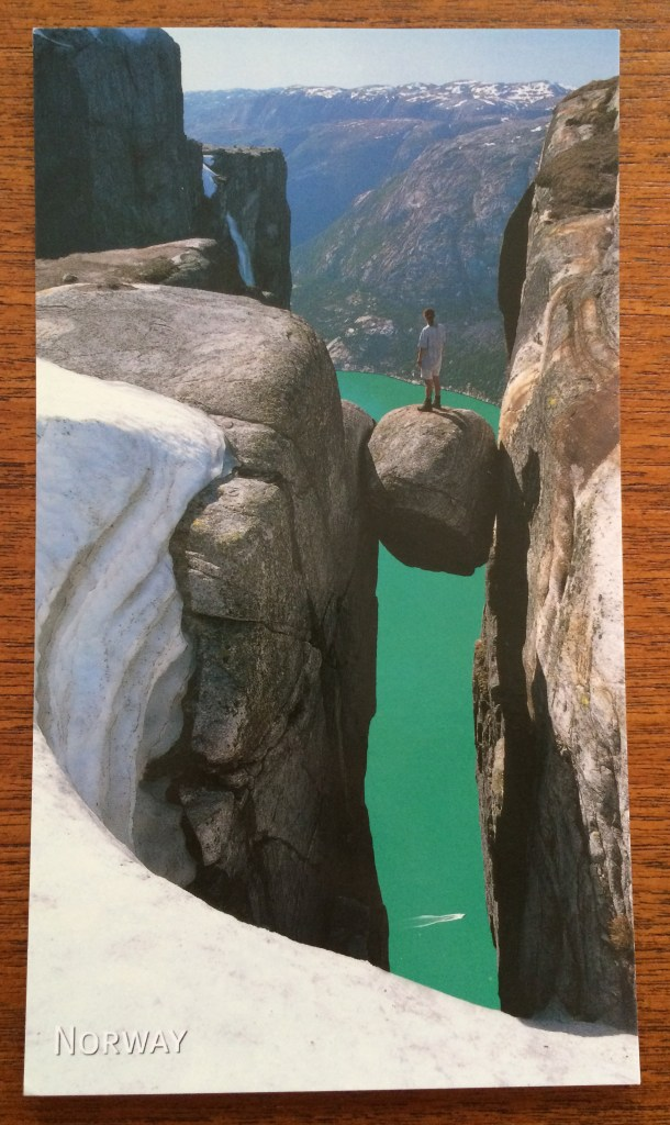 Postcard of kjeragbolten, famous rock wedged between cliffs in Norway