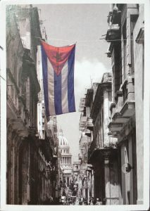 image of Cuban flag hanging in from of the capitol