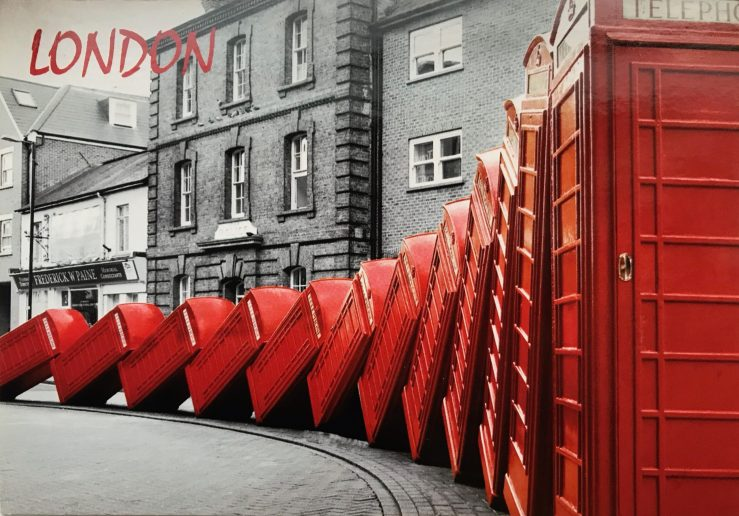 image of tipped over red telephone booths