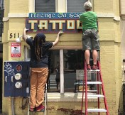 Hanging the sign (1)