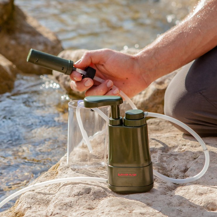 Young-Man-hiking-outdoor-Lifes Everything You Need to Know About Finding and Purifying Water in the Wilderness