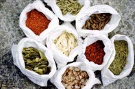 TCM uses herbs, acupuncture and cream for skin treatment