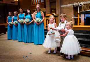 Ringbearer and the flower girls exchange a hug after coming down the aisle