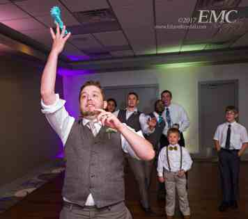 Bobby throws the garter to his group of single guys during the reception