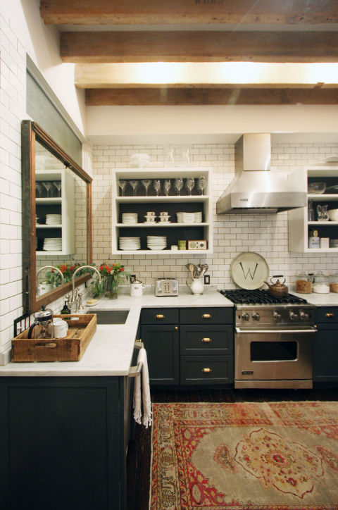 This year, kitchens are eschewing the perfect, polished look for a more eclectic vibe. Instead of only incorporating one or two materials, homeowners are turning to a variety of opposing styles to create a truly personalized space. This Manhattan kitchen, which features a rustic wood ceiling, a white subway tile backsplash, a vintage inspired rug, and shiny white countertops, is a perfect example.