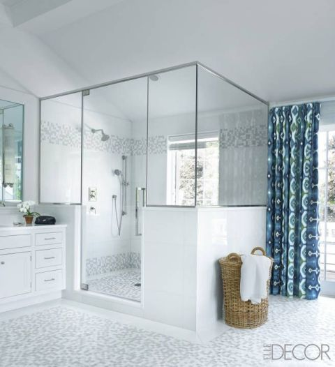 In Jimmy Choo designer Tamara Mellon's Hamptons house, the floor and shower stall in the master bathroom are sheathed with mosaic tiles.