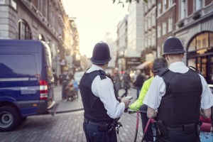 Two police officers look down a London street