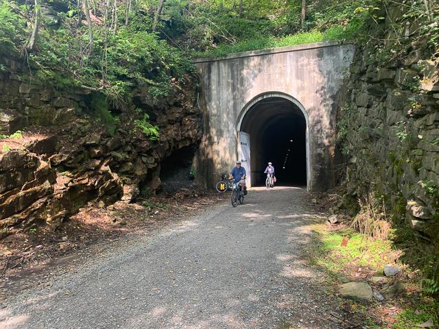 Cyclists exiting the Big Savage Tunnel toward Cumberland