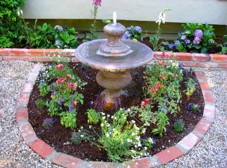 Recycled brick used as garden edging in English tea garden
