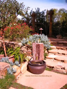 Planter used as water hose storage
