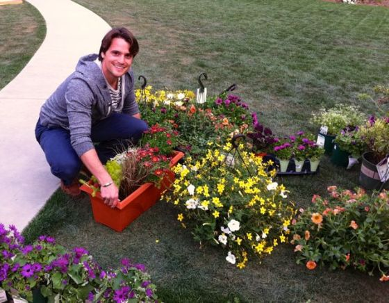 Nick Birren, producer at Home and Family Show gets involved in the deck makeover segment by unloading plants and soil.