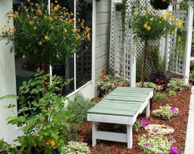 small-narrow-garden-bed-makeover-hanging-plants-arbor-bench-full-view-edenmakers-shirley-bovshow