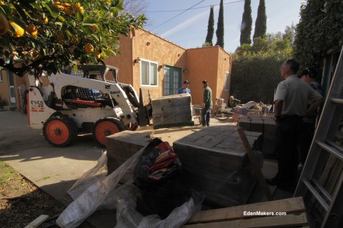 bobcat-carrying-pallet-of-pavers-landscaping-site-edenmakers-blog
