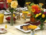 Outdoor Table Setting with tile table, roses, muffins and fresh fruit