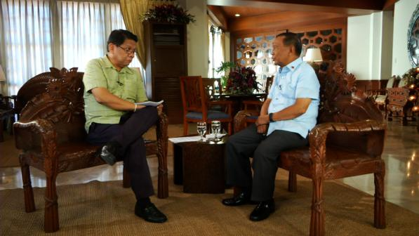 "Mike Enriquez and Jojo Binay on ""Wanted: President."" (GMA Network)"