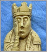 Facepalm Lewis chessman - blue bkgd border - Exeter Cecil genealogy deVere