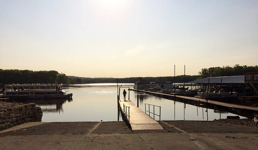 An empty dock on the Mississippi River in McGregor, Iowa. Photo by Rebecca Summer.