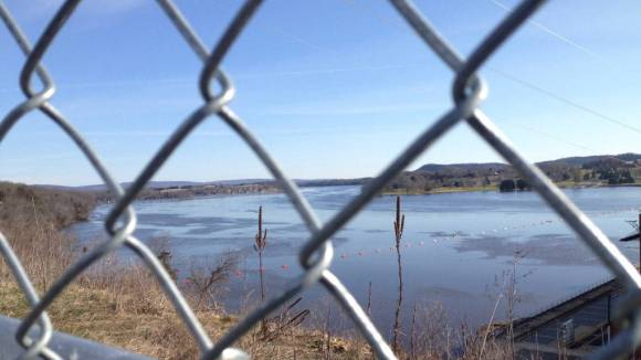 Looking upstream through the chain-link fence, 2016. Photo: Rob Lundberg.