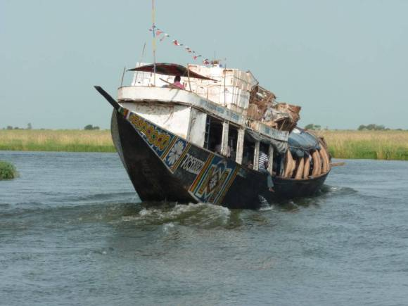A transport boat on the Niger Delta. Photograph by Pierre Hiernaux on October 26, 2014. Image used with kind permission.