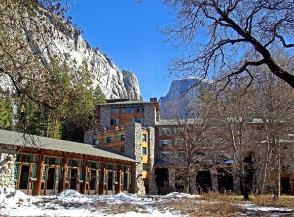 The Ahwanhee Hotel in Yosemite National Park, with the iconic peaks of Half Dome in the background. Photo credit: Creative Commons.