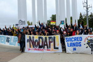 Demonstrators, led by activists from the Indigenous Environmental Network, gather in Bismarck, North Dakota to speak out against the proposed Dakota Access pipeline.Image by author, September 2016.