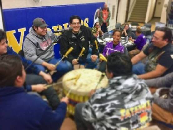 A drum circle performs on Thanksgiving in the Standing Rock Community High School gymnasium. Photo by Judy Wicks, November 2016.