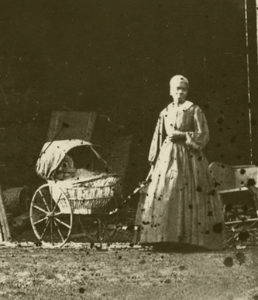 The only image of antebellum slavery at the University of Mississippi known to exist: an unnamed enslaved woman, standing behind the faculty residence of University of Mississippi Professor Edward C. Boynton, who took the photograph around 1860. Courtesy of the University of Mississippi Department of Archives and Special Collections.