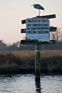 Land erosion has resulted in pipelines passing directly through marshlands and bayous. Loe.org, 2017.