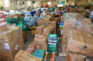 Cardboard boxes of supplies are gathered in a warehouse in New York, waiting to be shipped to Puerto Rico following Hurricane Maria.